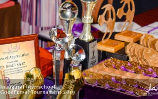 Images from the Interschool Futsal Tournament organized by Al Iman Schools. Trophy table at the awards ceremory.