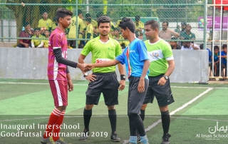 Images from the Interschool Futsal Tournament organized by Al Iman Schools. Captains of Royal Institute and MECC shaking hands